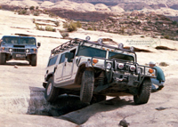 Hummer H1 Wagon scaling The Golden Crack in Moab, Utah.